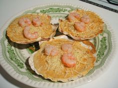 Cómo hacer conchas de vieiras rellenas de una pasta especial de merluza y gambas