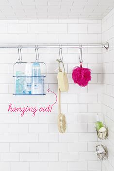 If shower shelving is scarce, consider a second rod placed near the wall. Outfitted with S-hooks, it can hold loofahs and bins of bath products — and keep your tub edge clear.