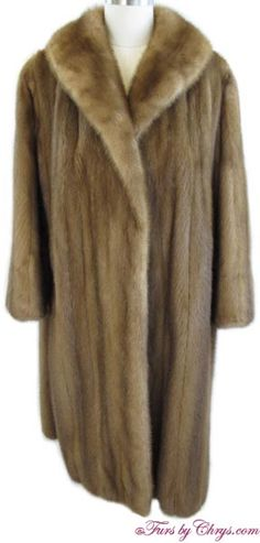 SOLD! Very Good Condition;  Size range: 8 - 12 Petite. This is beautiful genuine natural autumn haze mink fur coat constructed of female pelts. It features a shawl collar and straight sleeves. It has a taupe lining with an initial monogram and a gorgeous floral design embroidered on the side panels of the lining. It is an open design (no closures). When you want the warmth and glamour of real fur, reach for this enchanting autumn haze mink coat! Mink Coats, Mink Fur, Fur Coat, Side Panels, Monogram Initials, Shawl, Taupe, Floral Design, Glamour