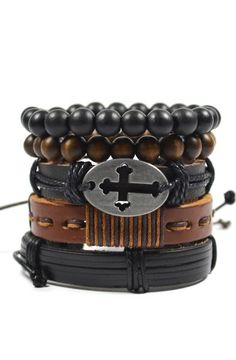"Product Details - 5 Piece Set - This 5 Pack Pack Brown and Black Cross Set includes 2 beaded bracelets made of 10mm bamboo wood, 1 black leather pull-closure bracelets with a cross accent, and 2 leather pull-closure bracelets.  - Wear them all together or separately depending on the look and occasion. Color: Black/Brown Material: Leather, Cord, Alloy, Wood Measurements: 8""L Origin: USA"