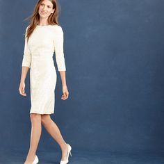 For a textured twist on tradition, our designers hand applied two different sequins to create a shimmering fish-scale effect on an easy dress that shines with every shimmy. Finished with three-quarter sleeves and designed with a bit of stretch to help you catch your breath (you can thank us later), it's the perfect little white dress for your wedding day, rehearsal dinner, afterparty...well, you get the idea. <ul><li>Falls above knee.</li><li>Poly.</li><li>Back…