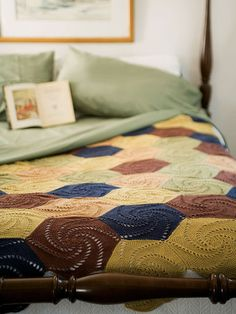 """A colorful crocheted coverlet is pieced together from swirled hexagons worked in coordinating shades. Skill level: Intermediate  Size Approximately 63"""" wide x 72"""" long  Materials 5 Hanks Berroco Weekend DK (100 grs), # 2976 Dark Denim, 6 hanks #2964 Curry, 5 hanks #2957 Grape, 3 hanks #2971 Squash and 3 hanks # 2965 Terra Cotta Originally shown in:"""