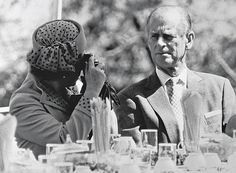 SNAPPING BACK: Over her 60 years as Queen, she must be the most photographed person in the world. Here she takes a snap of her own - of the Duke, with her in China in 1986