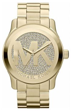 This beautiful iconic Michael Kors MK5706 womens quartz watch features gold pave with embossed MK logo. With a striking, oversized logo, this Michael Kors Runway timepiece shines in gold-tone stainles
