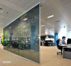 Floor to ceiling glass dividers can also be a writing surface for collaboration.
