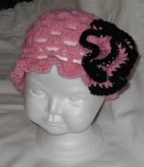 """Cool Black & Strawberry Crocheted Hat, an exclusive of www.JewelsDesigns.org  Sizes: NB-12m (16"""" to 18"""" circuference)-18m-5yrs (19"""" to 22"""" circumference). Choose your color and size. Ruffled Edge, Large Carnation. Flower can be worn on the front or..."""