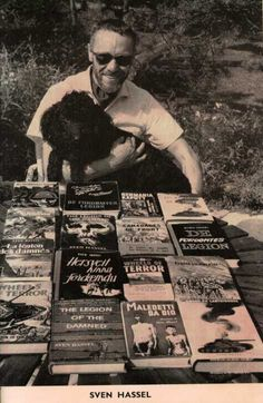 Sven Hassel with copies of his books in various languages