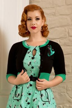 Looking kitty has never been so easy in this 60s Jade Cat Cardigan! ''Money spent on clothing with cats is never wasted'' ;-) This cutie features a row of shiny black buttons, contrasting emerald green boards and an amazing atomic kitten application. Made from a soft, stretchy, fine knitted, black viscose blend for a comfortable and perfect fit.Crazy? Every now and then. Cat lady? All day, EVERY day!   Shorter style Round neckline Row of black buttons 3&#x2...