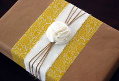 use paper and fabric scraps to decorate brown wrapping paper and make a darling present