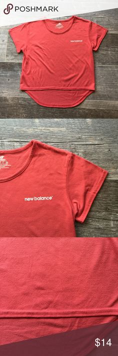 Persimmon Red New Balance High Low Tee Size Small Persimmon Red New Balance High Low Tee. Size Small. In used condition with some pilling. New Balance Tops