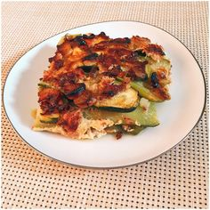 zucchini gratin with tuna and onions on top of the gratin (And 2 eggs on it)