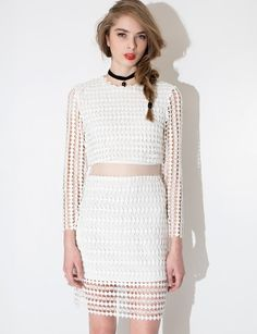 Oh so cute and chic white perforated lace dress with organza mid sheer panel and sheer lace long sleeves. Has hidden back zipper and is partially lined. Style this white lace cocktail dress with strappy heels. *100% polyester*32