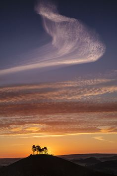 Cirrus clouds above Colmers Hill in Dorset, England