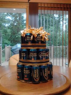 Birthday Bud Light Cake!  All you need is approximately 50 beers, 1 8,10, and 12 inch circle pan and cardboard.  Cut out each circle and start stacking!