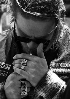 Jax... love his hands, the rings, the way he lights his cigarette.