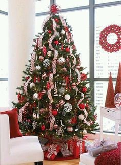 White Christmas Tree Decorating Ideas With Ribbons Cascading Down Sides.