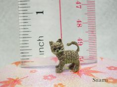 Tiny Gray Cat - Micro Crocheted... 55.00, via Etsy. thx for object for scale:-)