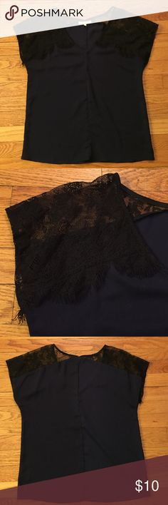Black & blue polyester blouse Black & blue polyester blouse lacey/fringy shoulders. Under Skies Tops Blouses