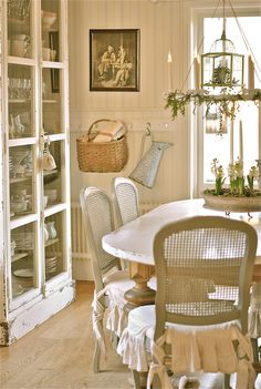 Stacking the two glass front cabinets can make our own version of this.  Cozy cottage dining nook - Love this Swedish decor blog!