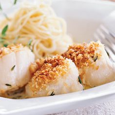 Hazelnut Crusted Scallops 5 tablespoons butter, divided ½ cup dry white wine ¼ cup heavy whipping cream 1 teaspoon fresh thyme ¼ teaspoon salt ¼ teaspoon freshly ground black pepper Pinch of grated or ground nutmeg 1 pound sea or bay scallops, drained ¼ cup panko (Japanese breadcrumbs) ¼ cup finely chopped hazelnuts Hot cooked pasta Garnish: fresh thyme sprigs