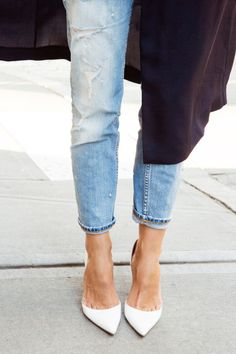 White pumps go perfectly with light wash denim.