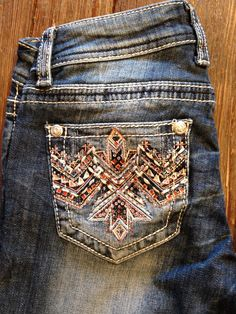 Grace Jeans in medium wash, boot cut, with pink, white and blue phoenix bling Flat pockets
