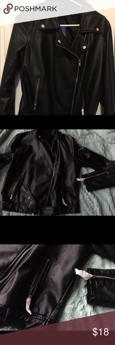 NWT Forever 21 Faux Leather Jacket Large Forever 21 never worn (she's even still got some tissue wrapped on those zippers!) faux black leather jacket. Zipper front with buttons on the lapels. Two zipper side pockets and zipper sleeves. Belted bottom. Size large. Forever 21 Jackets & Coats
