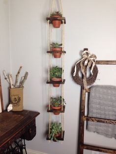 5 Tier With Pots Vertical Planter Wood Hanging Terracotta by TheMiteredJoint on Etsy https://www.etsy.com/listing/258215810/5-tier-with-pots-vertical-planter-wood