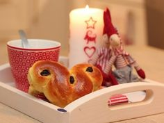 """Santa Lucia with Norwegian """"lussekatter"""" (sweetbread with safron and raisins). Recipe by Trine Christmas And New Year, White Christmas, Christmas Candle, Christmas Crafts, Norwegian Food, Christmas Entertaining, Santa Lucia, Christmas Breakfast, Scandinavian Christmas"""