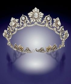 A MID-19TH CENTURY DIAMOND TIARA Composed of a series of nine old-cut diamond graduating flowerhead clusters centred by old-cut pear and cushion shape diamond collet highlights, interspersed by ten similarly-set stylised cusp motifs of ribbon scroll design, raised on an undulating diamond line frame, mounted in silver and gold, circa 1850. Each flowerhead cluster detachable to form a brooch.