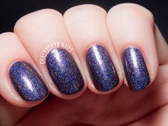Glam Polish Desperate Souls via @chalkboardnails. Desperate Souls is a deep, blackened purple with a holographic finish. It has a pretty green shimmer to it that shifts to a warm pink when seen at an angle, though unfortunately I had a tough time capturing it in my photos. Two coats.