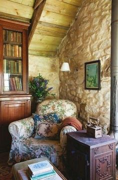 Lovely, cozy reading nook...just want to take the latest book I am reading and a glass of wine and loose myself in that book here!