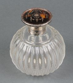 """Lot 475 An Edwardian silver and tortoiseshell pique scent bottle and stopper, Birmingham 1910, 4 1/2""""  Est £50-100"""