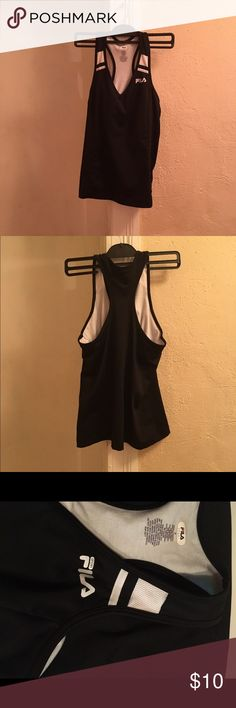 Black FILA Sport Tank top Black and white FILA work out tank top. No fading in good condition  Has white lining inside  Size M Material is spandex and polyester Fila Tops Tank Tops