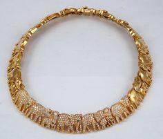 CARTIER Diamond Elephant Necklace. 18k yellow gold. Yafa Jewelry