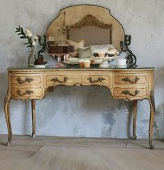 Vintage vanity in pale olive with gold gilt foliage carvings.