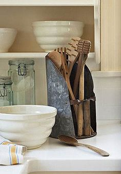 Show Off Collectibles    Items found at antiques stores can stand in for traditional utensil storage. This grain scoop adds authenticity to a country-style kitchen while serving a practical purpose.