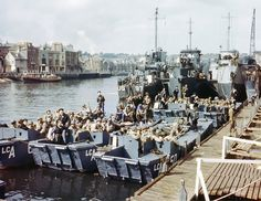 1- June 1944: Boats full of US troops wait to leave Weymouth to take part in Operation Overlord. 5 April 2014: A view of the harbour of the English town today. This location was used as a launching place for Allied troops participating in the invasion of Nazi-occupied France on D-day. Photographs by Galerie Bilderwelt/Getty and Peter Macdiarmid/Getty