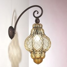 A few of these Venetian Glass Chandeliers would be fabulous although I don't know where I would put them