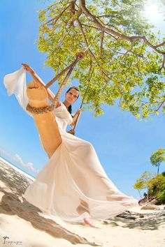 beautiful bride on beach swing  Photography by TropicPic   #beach #swing #bride Click the picture to see the whole photoshoot!