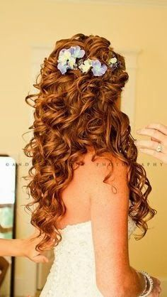 I LOVE the amt of curls for this one, add some criss cross on the top and the rope braid you can kinda see by her ears in the pic, MAYBE a bohemian braid? and pincurls in the back, coming to one side, so it looks like a side look, but it comes down on both sides and then add the flowers throughout the hair