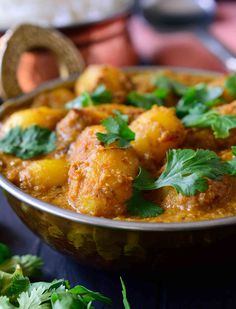 This spicy vegan potato curry is full on with flavour and easy to make with pantry staples. Fried potatoes simmered in a spicy tomato-cashew sauce.