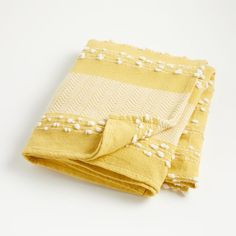 Our textured throw blanket features simple patterns with dotted and diagonal lines. This go-anywhere blanket was made from 100% cotton and will bring extra coziness to any nursery or kids room in your home. Plus, thanks to the versatile look, it's also perfect for snuggling up together in the family room.    Yellow throw blanket with white detailing   Features textured patterns   100% cotton   Machine washable   Made in India Kids Blankets, Soft Baby Blankets, Cozy Blankets, Yellow Throw Blanket, Yellow Home Decor, New Kids, Crate And Barrel, Linen Fabric, Crates