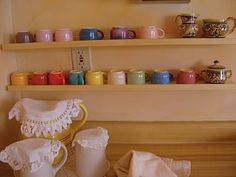 Love these shelves, doily over pitchers xoxo