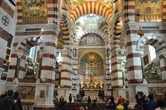 Inside Notre-Dame de la Garde, a Catholic basilica in Marseille, southern France. A silver statue of the Virgin of of Chanuel (1837) dominates the main altar of the basilica (lower middle of picture). It replaced one melted down during the French Revolution.