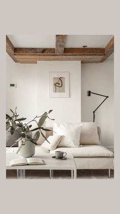 Calm living room in neutral colours. Styling and photo by @likehomeamsterdam Featuring Abstract Art Print Two ways created exclusively for The Poster Club by Anna Johansson. ⁠Copenhagen-based online store offering an unique curated selection of high quality posters and art prints from both upcoming and established artists. Worldwide shipping! #art #artprints #artposters #theposterclub #interiordesign #nordicdecor #homestyling