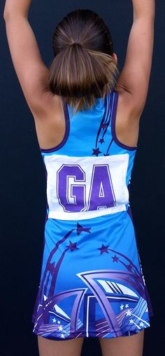 Loads of netball clubs have moved away from netball bodysuits towards this A-Line Racerback Netball dress. We took the opportunity to redesign Kingscliff Netball Club's netball dress design when they changed the style. The cyan is so vibrant and compliments the purple trim and highlights nicely. #kingscliffnetballclub #netball Netball Uniforms, Sports Uniforms, Netball Dresses, Sports Jersey Design, Uniform Design, Long Sleeve Polo, Bodysuits, Compliments, Designer Dresses