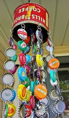 Strings of bottle caps hanging from an old coffee tin make the perfect chimes in this repurposed porch decor.