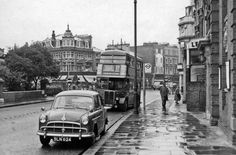 View NE, towards Westbourne Grove and Chepstow Road, West London, England. Featured are the photographer's first Morris Oxford and a bus headed for Hammersmith on Route 27 (Archway - Teddington). Date 3 May 1959 Ben Brooksbank Mode London, London Bus, London Bridge, London Life, West London, London History, Local History, Old Pictures, Old Photos