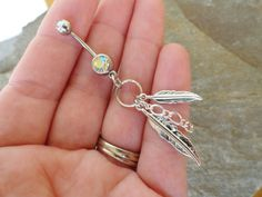 Feather and Chain Belly Button Ring, Silver Feather Barbell Navel Piercing from Midnights Mojo. Saved to jewelry:). Double Bellybutton Piercings, Belly Button Piercing, Body Piercings, Cute Belly Rings, Belly Button Rings, Nose Rings, Cute Jewelry, Body Jewelry, Jewlery